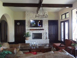 TV Mounted on Stone Fireplace