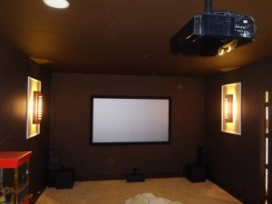 Theater Room with beautiful lighting fixtures, Screen Innovations Black Diamond, JVC X10 Projector, and Revel Home Theater System